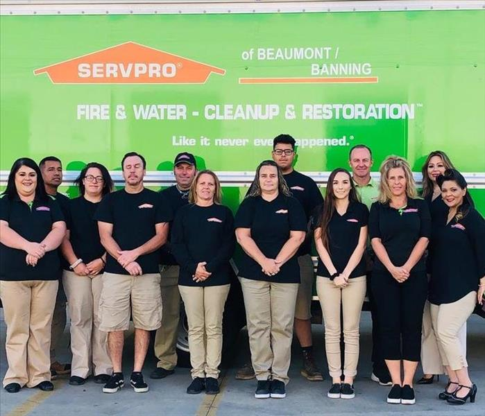 SERVPRO of Beaumont/Banning Crew Pose in front of Large Green SERVPRO Box Truck